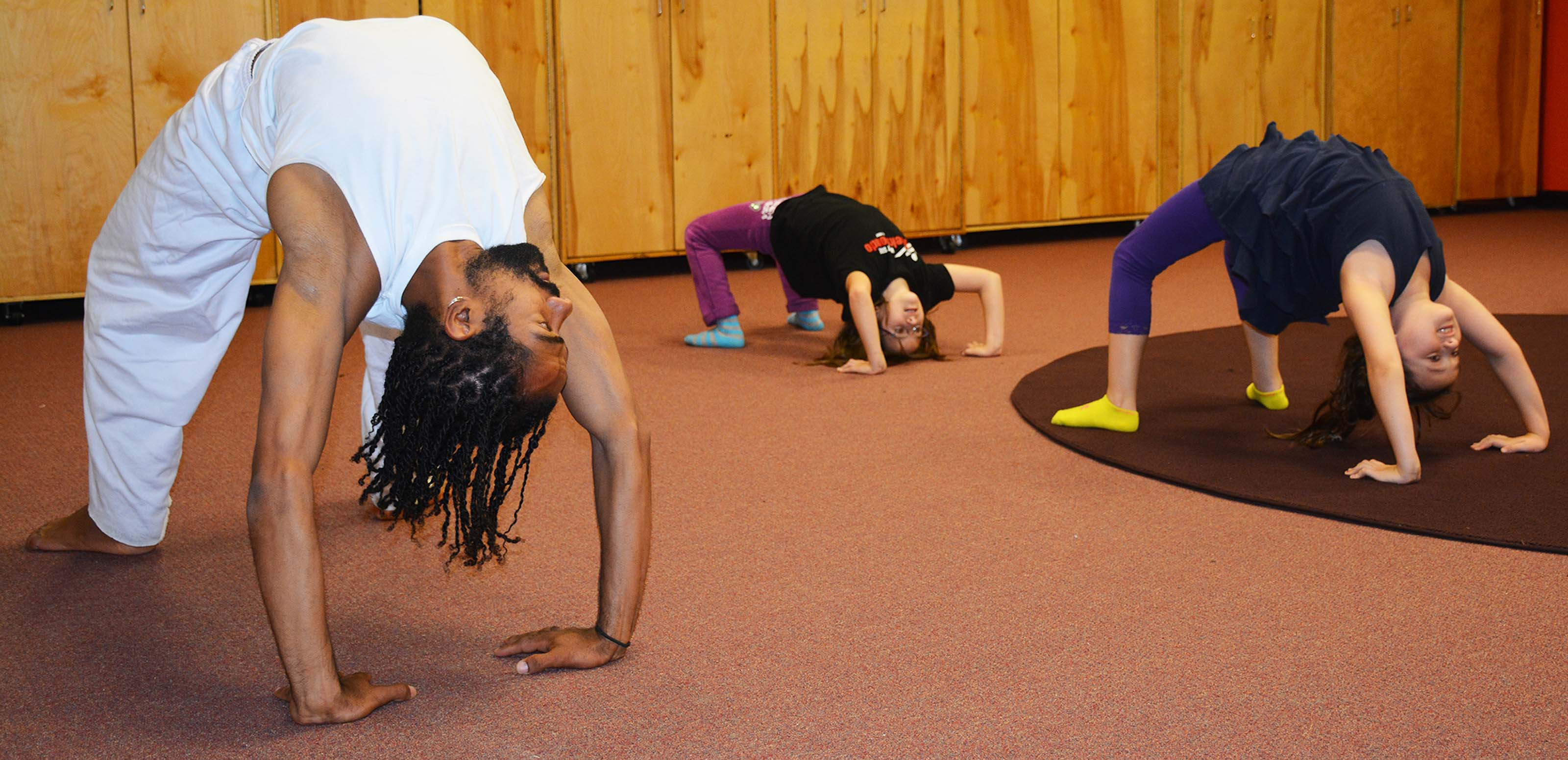 "Capoeira-practicing the bridge (""ponte"") position"