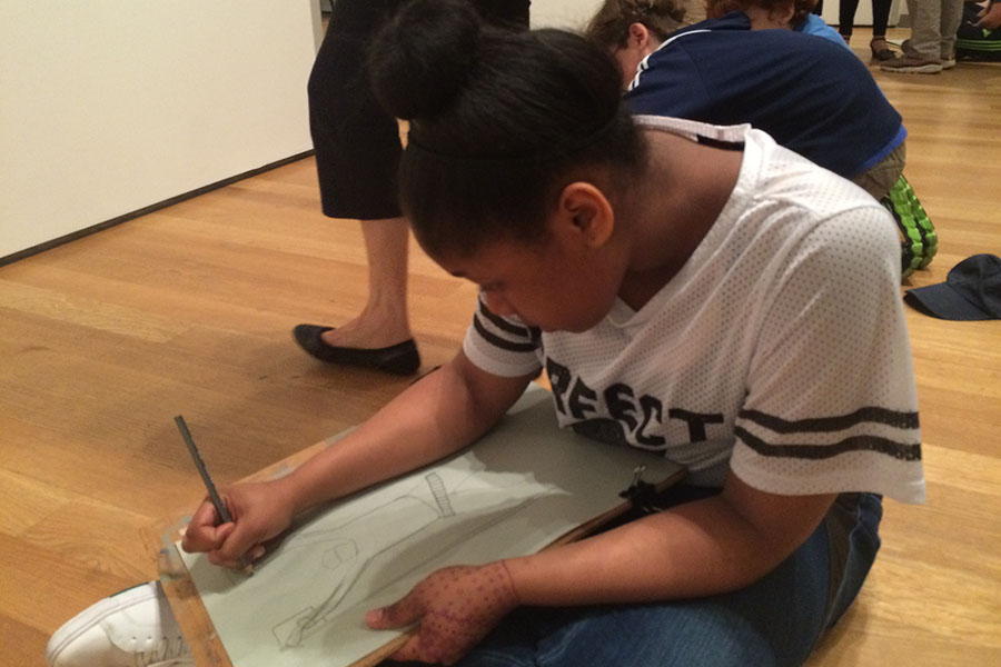 Student is concentrated on drawing