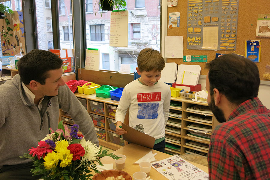 Students participate in playing Restaurant