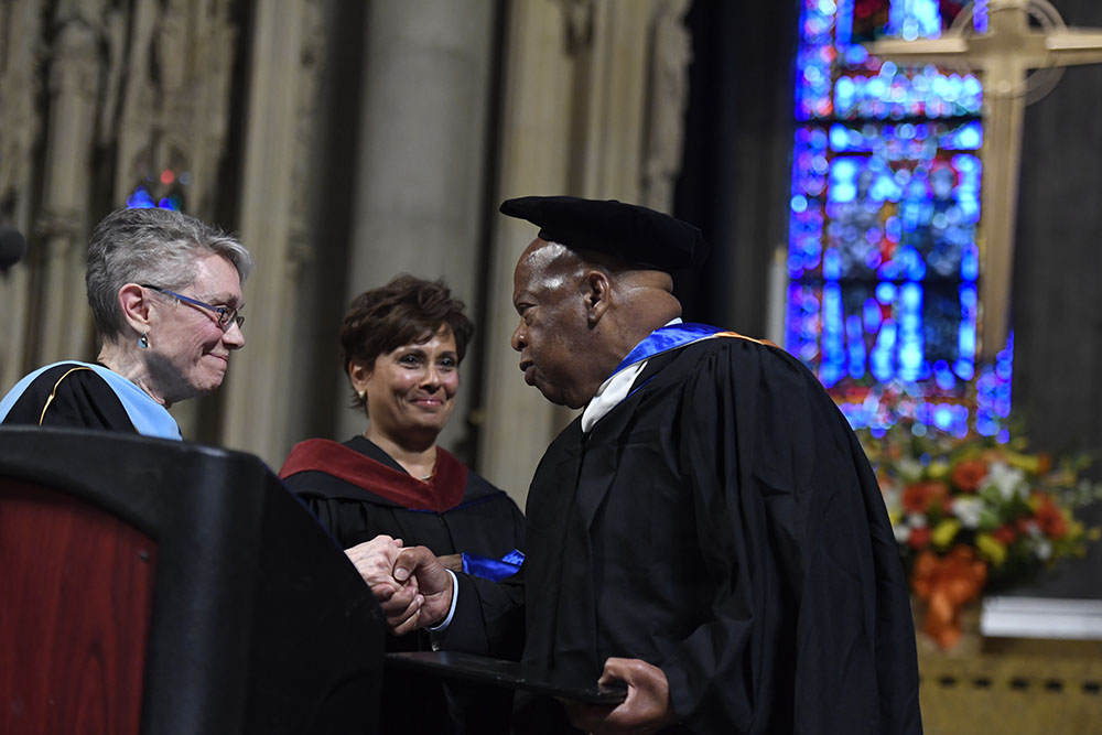 Rep. John Lewis receiving Honorary Doctorate from Dean Cecelia Traugh and Chair, Board of Trustees, Yolanda Ferrell-Brown