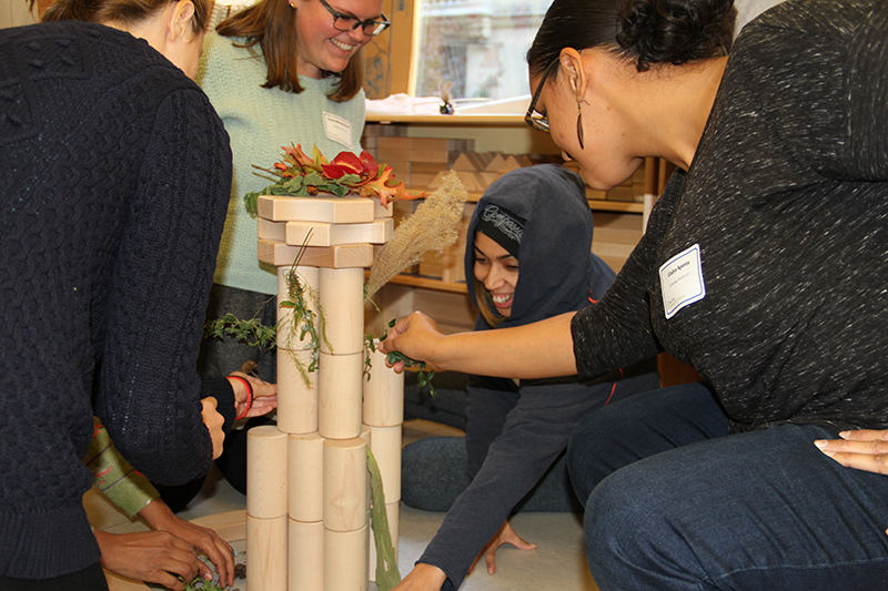 Attendees participating in a block-building workshop