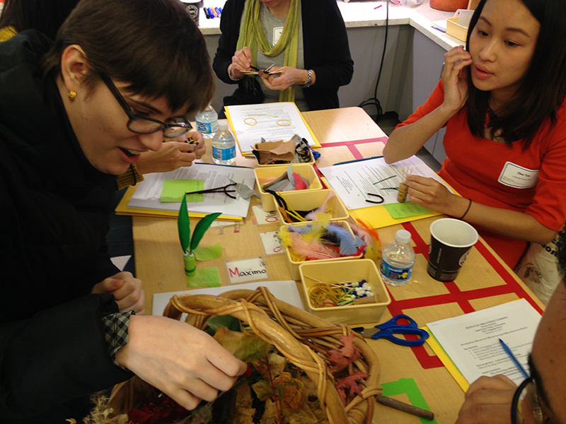 Workshop attendees working with a variety of materials and corks