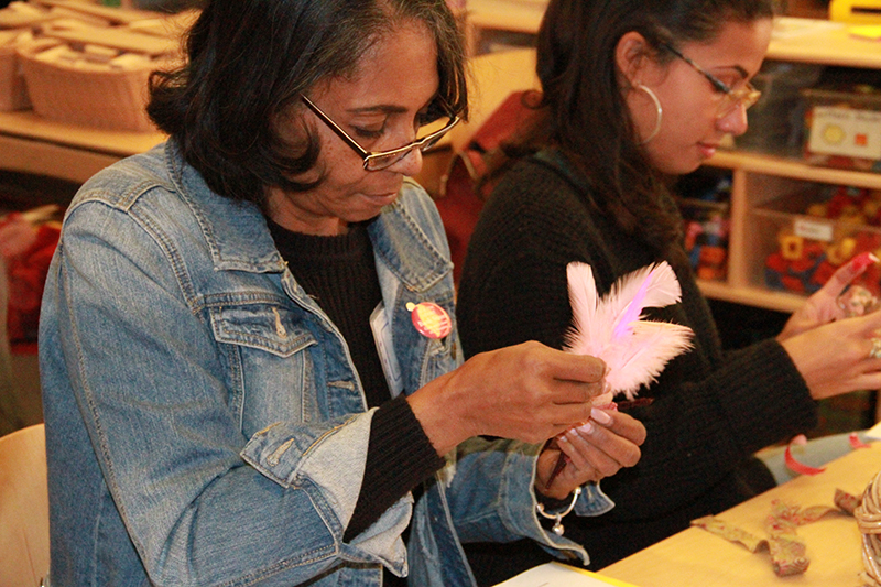 Workshop participant working with feathers